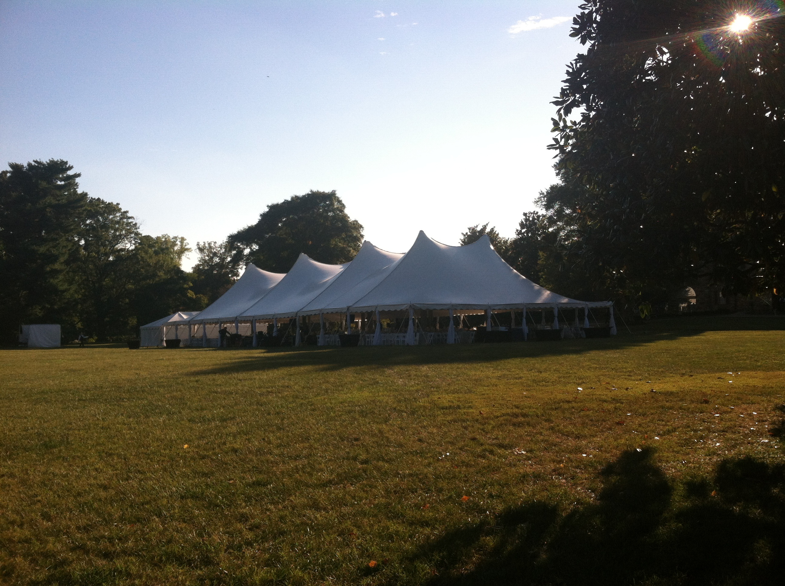 row of rental tents set up for wedding reception