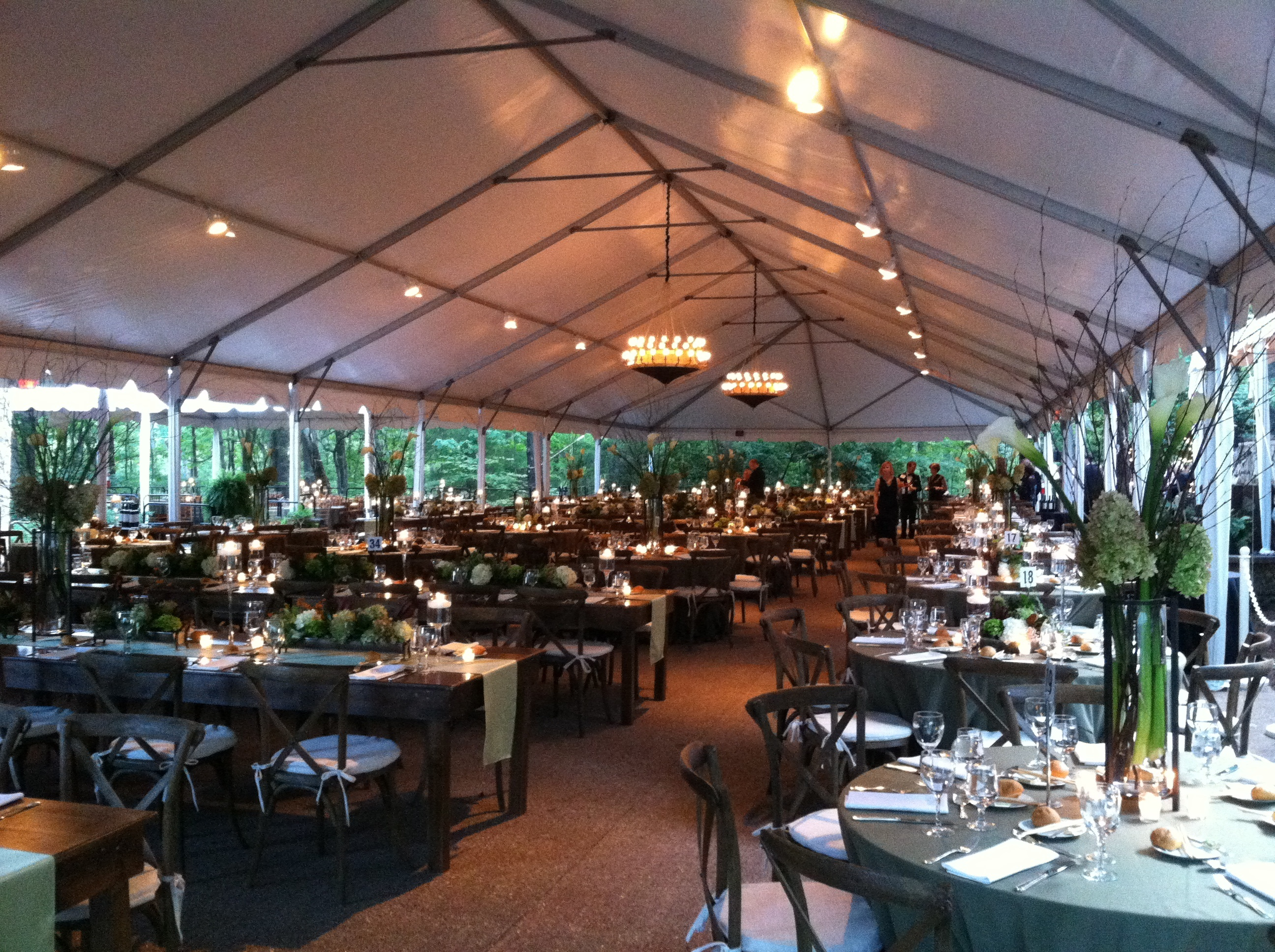 beautiful table settings in event tent
