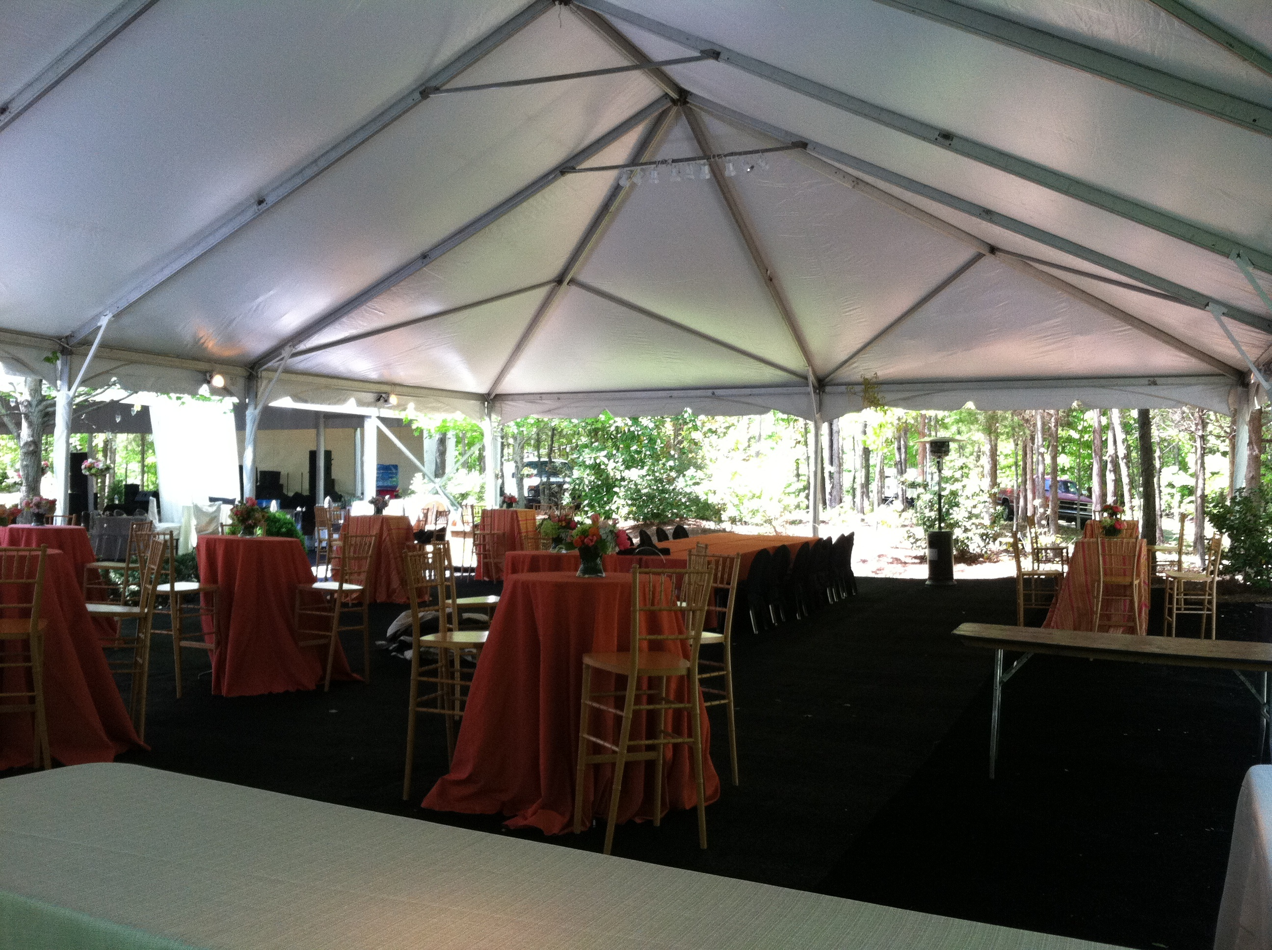 tables and chairs set up under tent for wedding reception